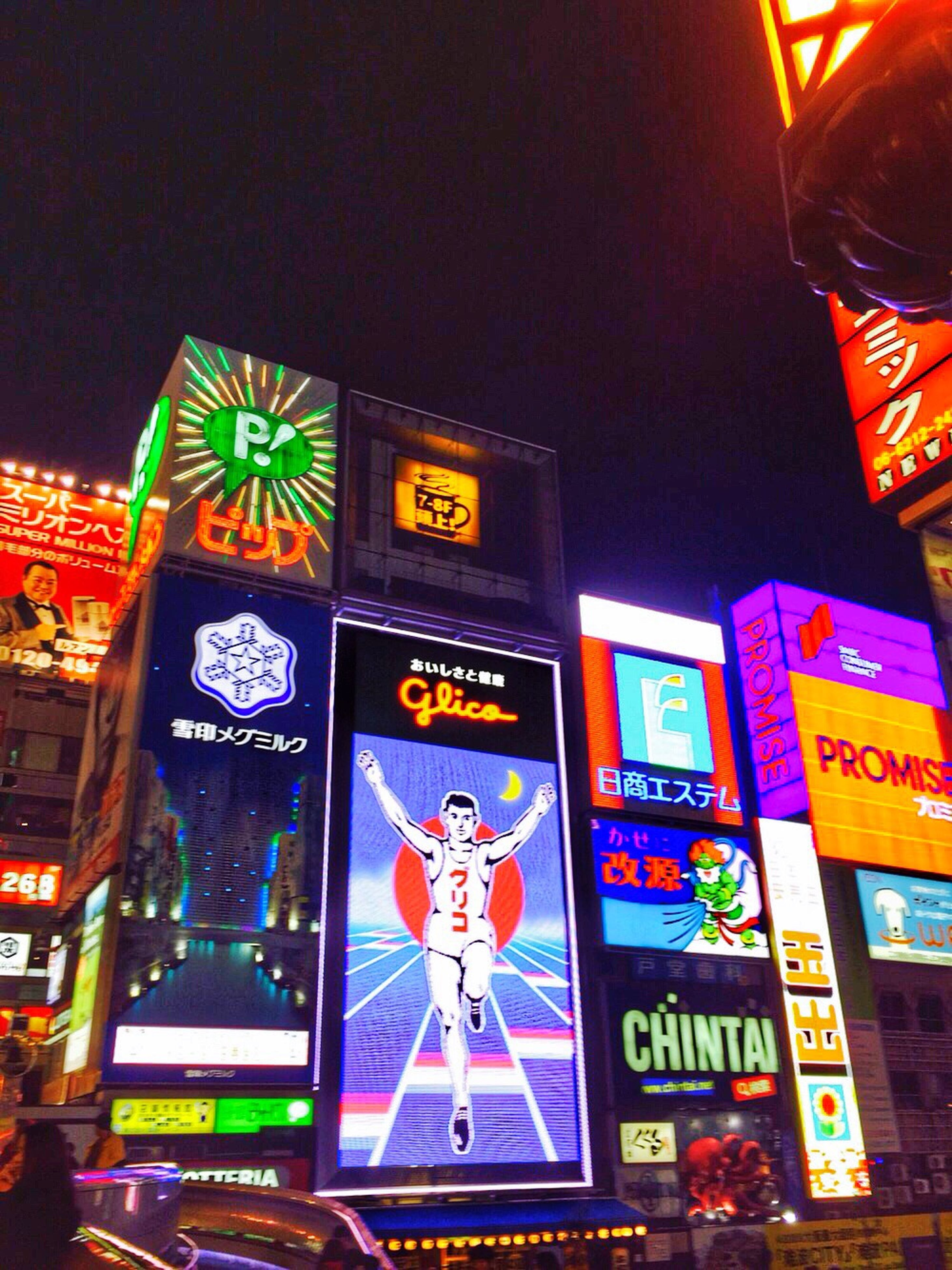 text, western script, communication, illuminated, night, non-western script, advertisement, sign, built structure, information sign, commercial sign, capital letter, information, architecture, low angle view, neon, multi colored, building exterior, city, number