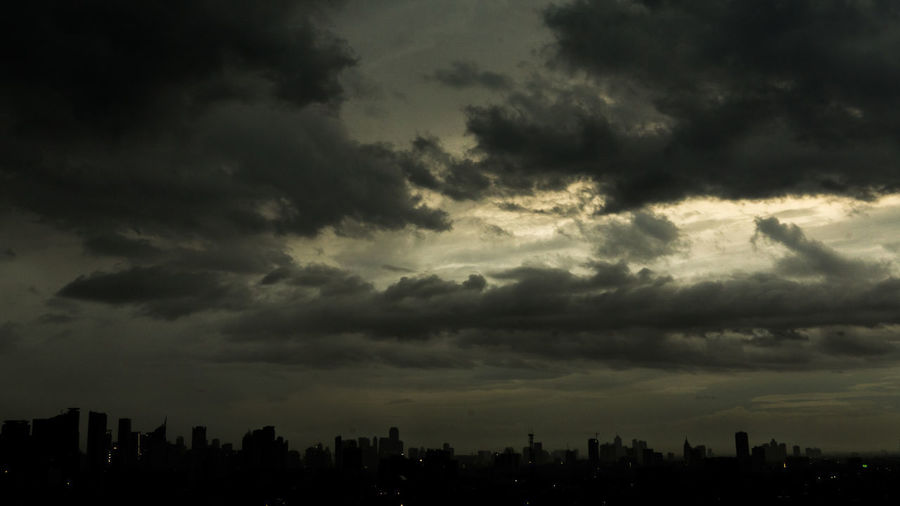 When Light Captured By The Darkness Beauty In Nature City Cityscape Cloud - Sky Modern Nature No People Outdoors Silhouette Sky Storm Cloud Sunset Urban Skyline