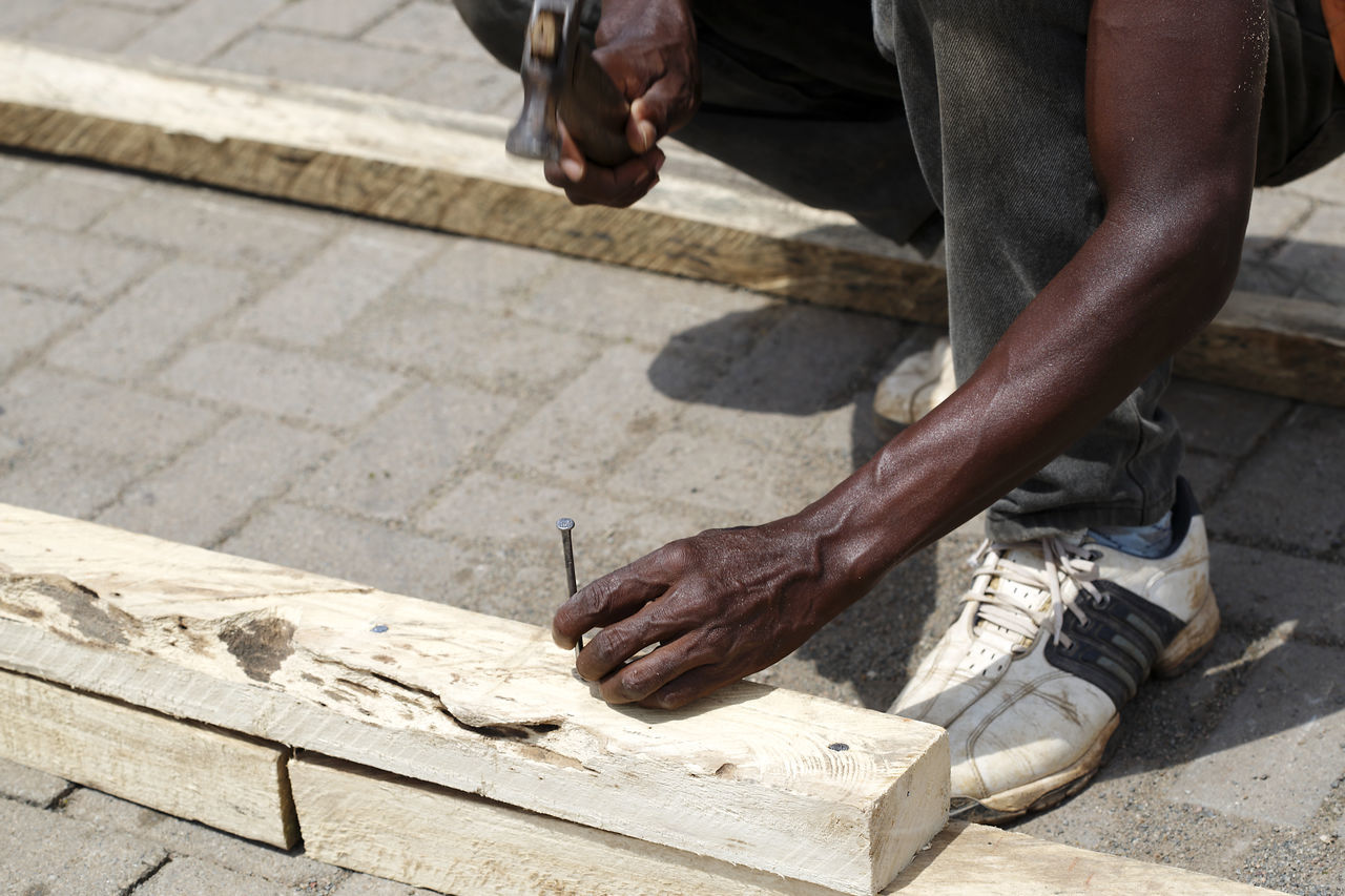 Adult Africa Business Finance And Industry Carpenter Charity And Relief Work Close-up Coin Day Ghana Human Body Part Human Hand Industry Low Section Men Occupation One Man Only One Person Outdoors People Social Issues Wood - Material