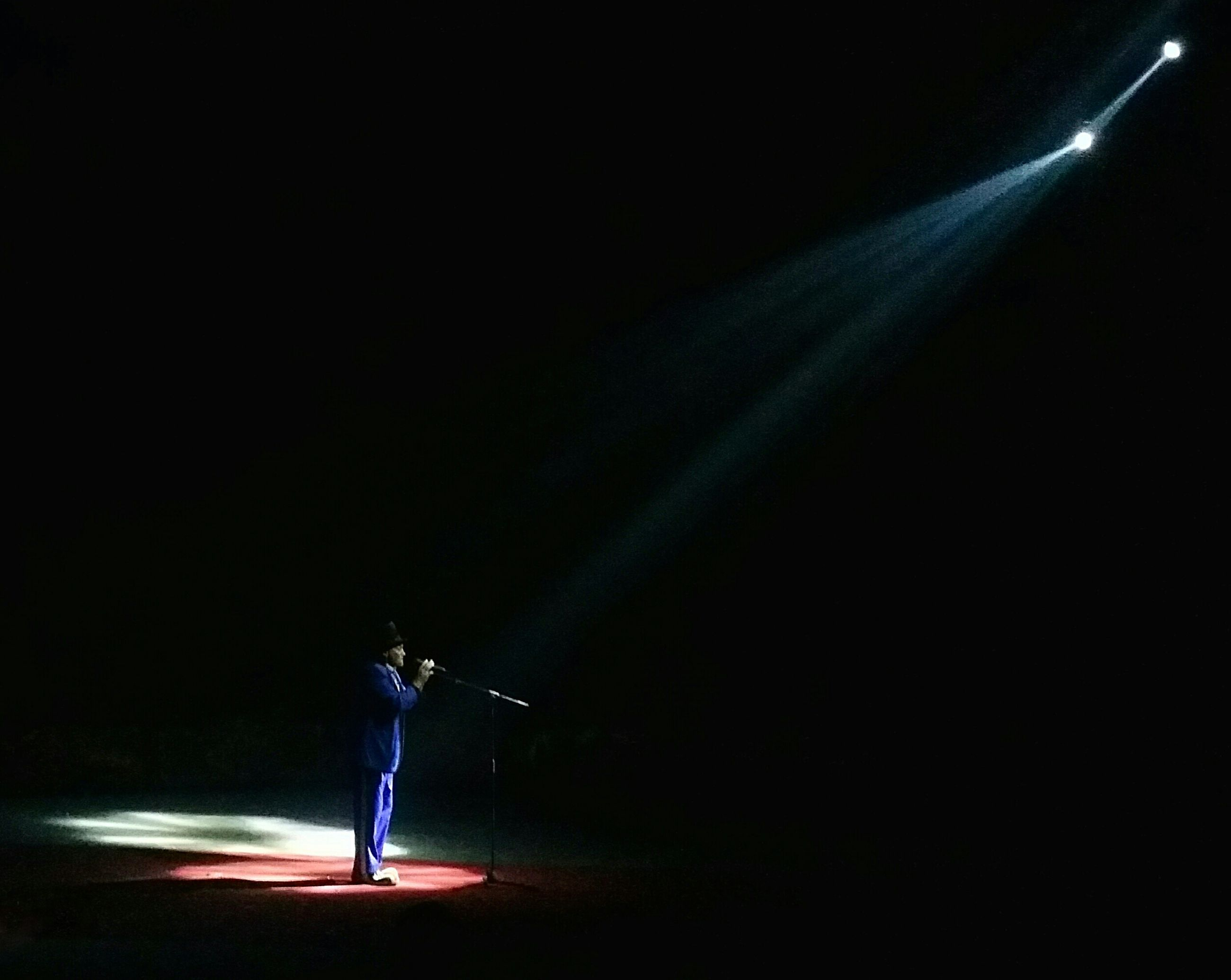 night, full length, illuminated, one person, stage - performance space, performance, spotlight, stage light, performing arts event, nightlife, indoors, young adult, people, adult