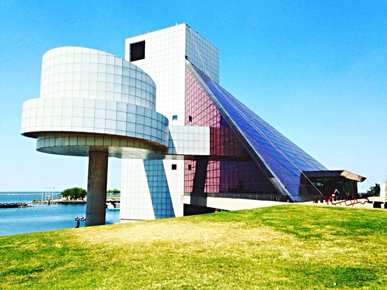 Architecture Building Exterior Built Structure Blue Sky Modern Rock N Roll Rock N Roll Hall Of Fame Grass Clear Sky Outdoors No People Day