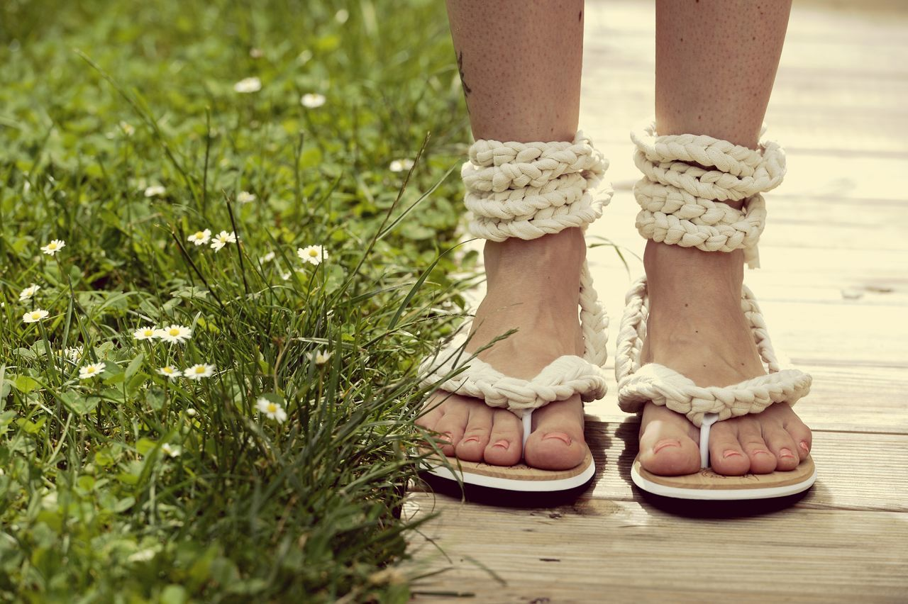 Low Section Human Body Part Human Foot Grass Limb One Person Shoe Human Leg Standing Green Color Outdoors Toe Day One Woman Only Close-up Spring Rope Stand Still Hand Made Flipflops Flipflops Handmade Hand Made Flipflops