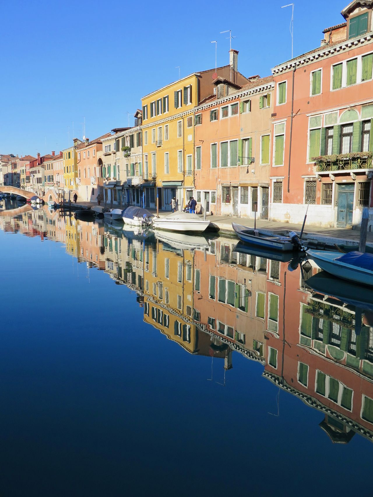Apartment Architecture Building Exterior Canal City Cityscape Clear Sky Day Gondola - Traditional Boat Italy Holidays Multi Colored Nautical Vessel No People Outdoors Reflection Residential Building Sky Symmetry Tranquil Scene Tranquility Travel Destinations Venezia Venice Water Waterfront