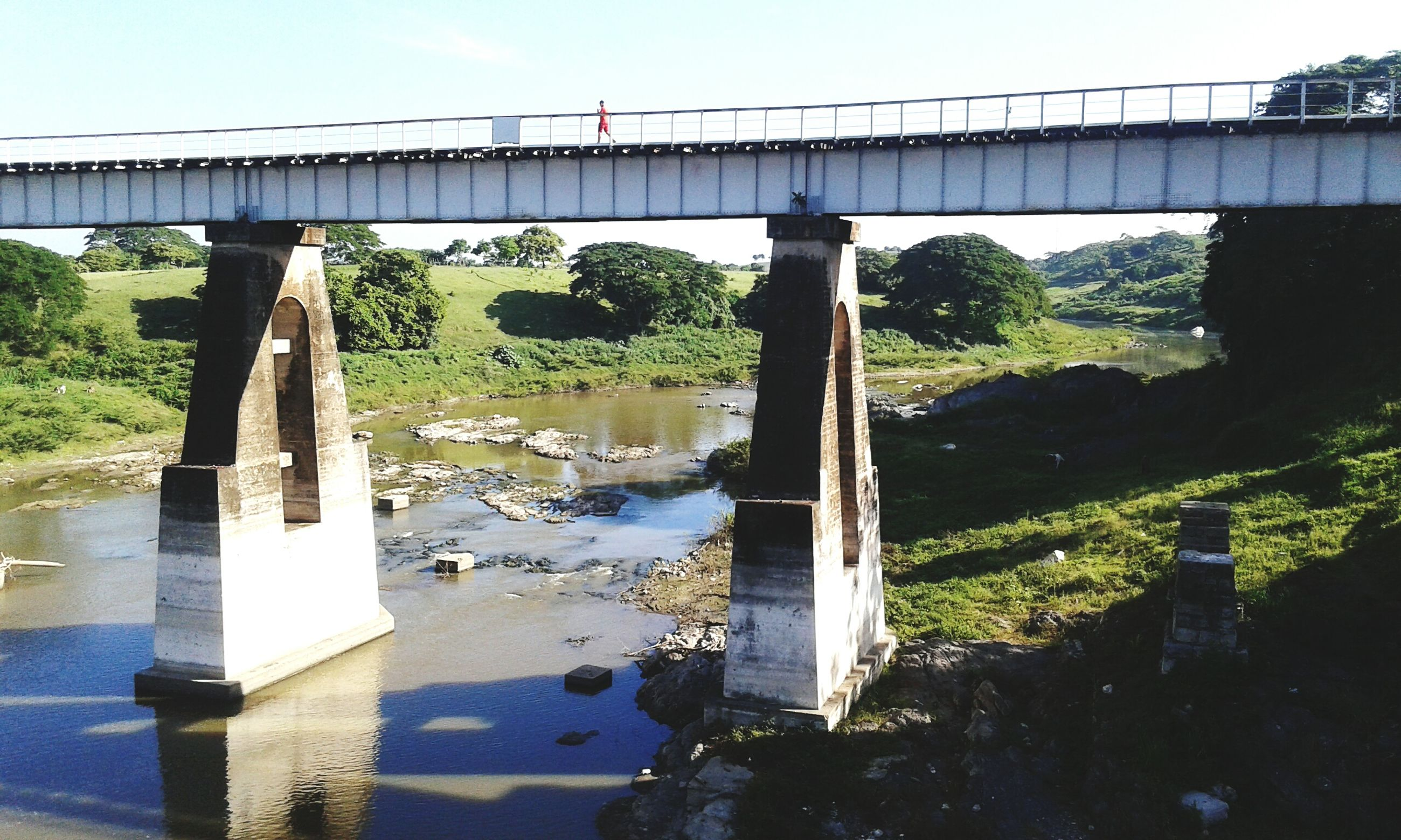 connection, bridge - man made structure, built structure, architecture, water, bridge, architectural column, river, engineering, sky, day, outdoors, canal, no people, green color, standing water