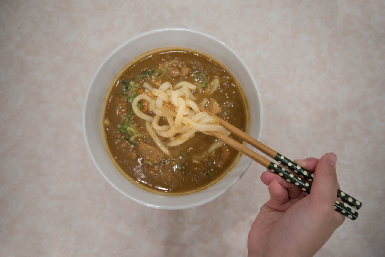 Ready to eat noodle. Adult Bowl Chopsticks Close-up Curry Day Food Freshness Healthy Eating High Angle View Holding Human Body Part Human Hand Indoors  Noodle One Person One Woman Only Only Women People Ready-to-eat Soup Udon