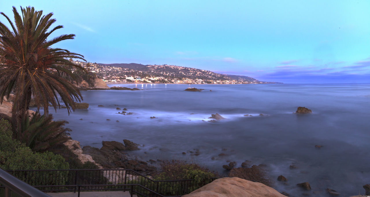 Panoramic sunset view of Main beach in Laguna Beach, Southern California, United States Beach Day Laguna Beach Sunset Laguna Beach, CA Main Beach Nature No People Ocean View Outdoors Panorama Panoramic Sea Sea And Sky Sky Tree Water