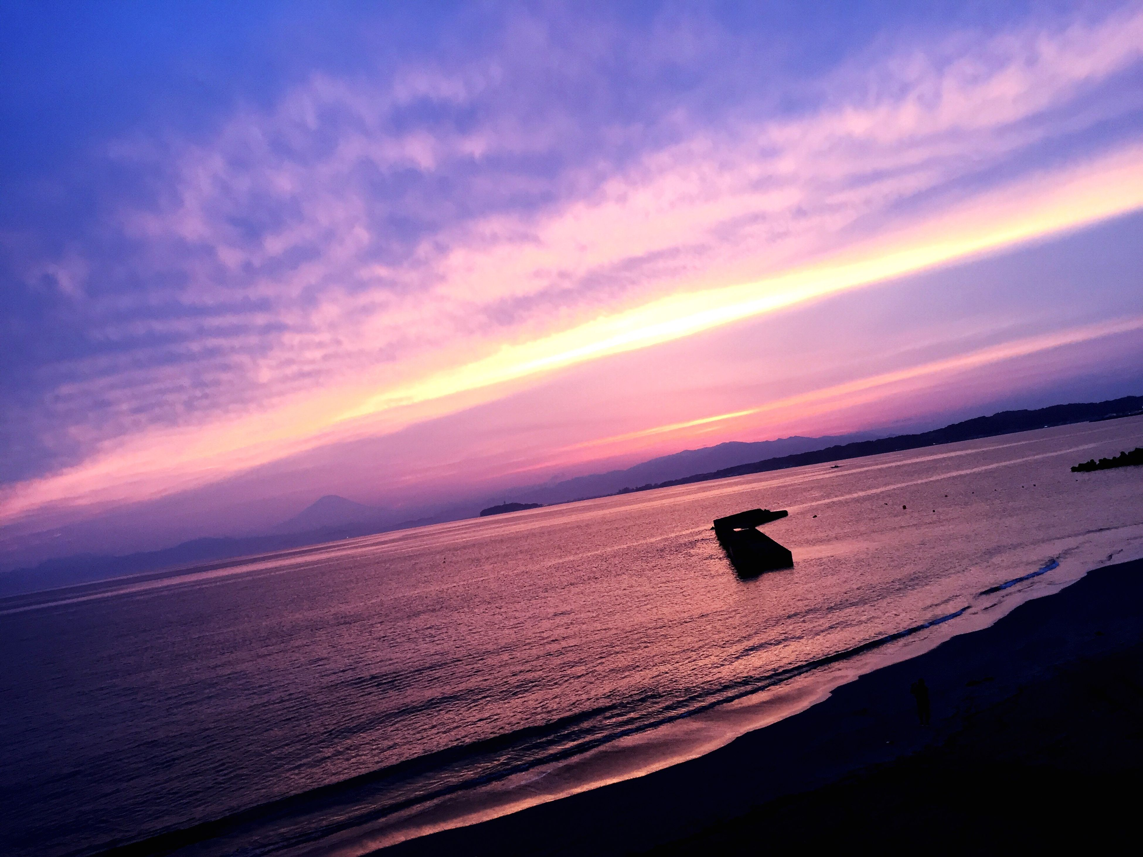 sunset, sea, beauty in nature, scenics, nature, silhouette, water, horizon over water, sky, orange color, tranquil scene, tranquility, beach, wave, cloud - sky, outdoors, no people, jet boat, nautical vessel, animal themes, mammal
