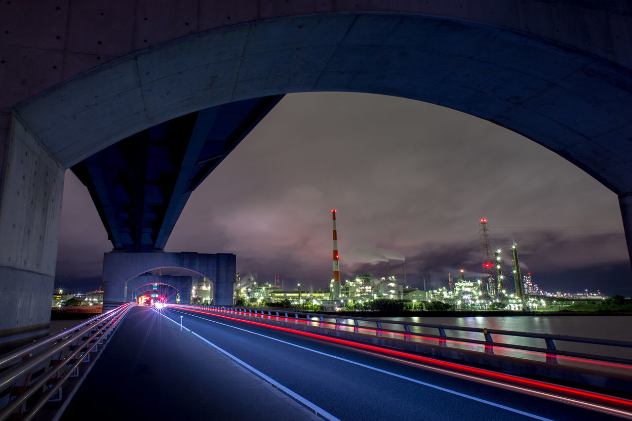 transportation, speed, architecture, bridge - man made structure, built structure, connection, long exposure, city, road, light trail, illuminated, motion, city life, no people, night, building exterior, travel destinations, outdoors, high street, sky