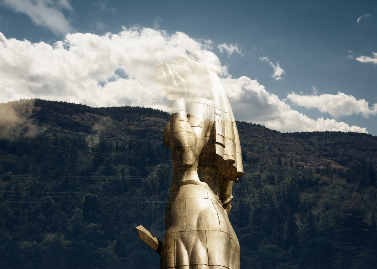 Guardian blue sky clouds Double Exposure historic Linas was Here Massive metal Momentum mountains Multiple exposure Statue sword woods