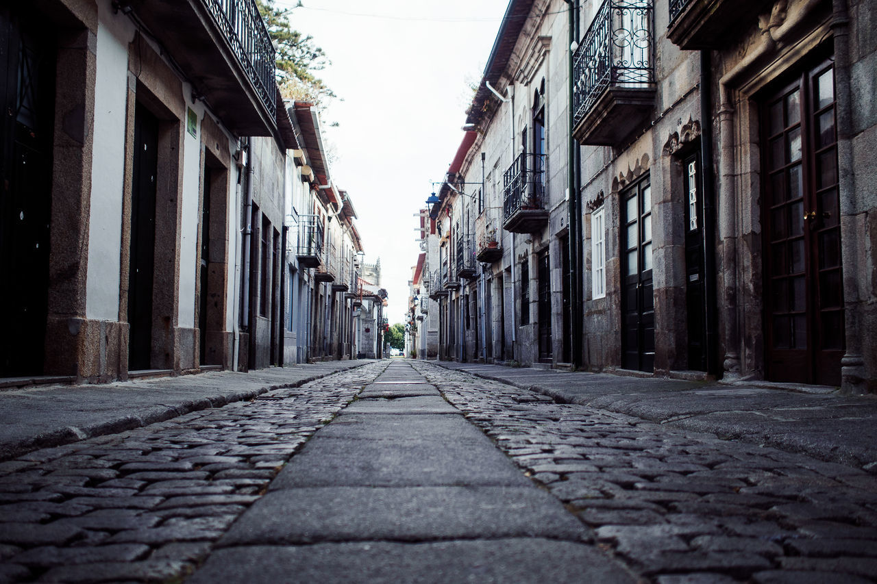 somewhere in Portugal Alley Architecture Building Exterior Built Structure Cobblestone Day Diminishing Perspective Hikinggalicia No People Outdoors Sky Street The Way Forward