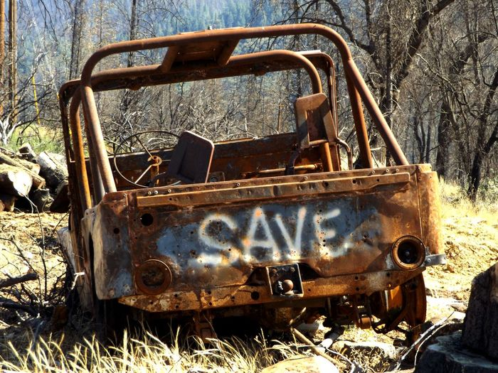 Abandoned Absence Automobile Bad Condition Broken Burned Damaged Day Deterioration Dirty Discard Empty Field Fire Grass Jeep No People Obsolete Old Outdoors Run-down Rusty