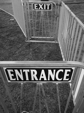 Easy in, easy out Communication Sign Guidance Information Sign Outdoors Journey Symbol No People Gateway Monochrome Black And White Sign Pathway
