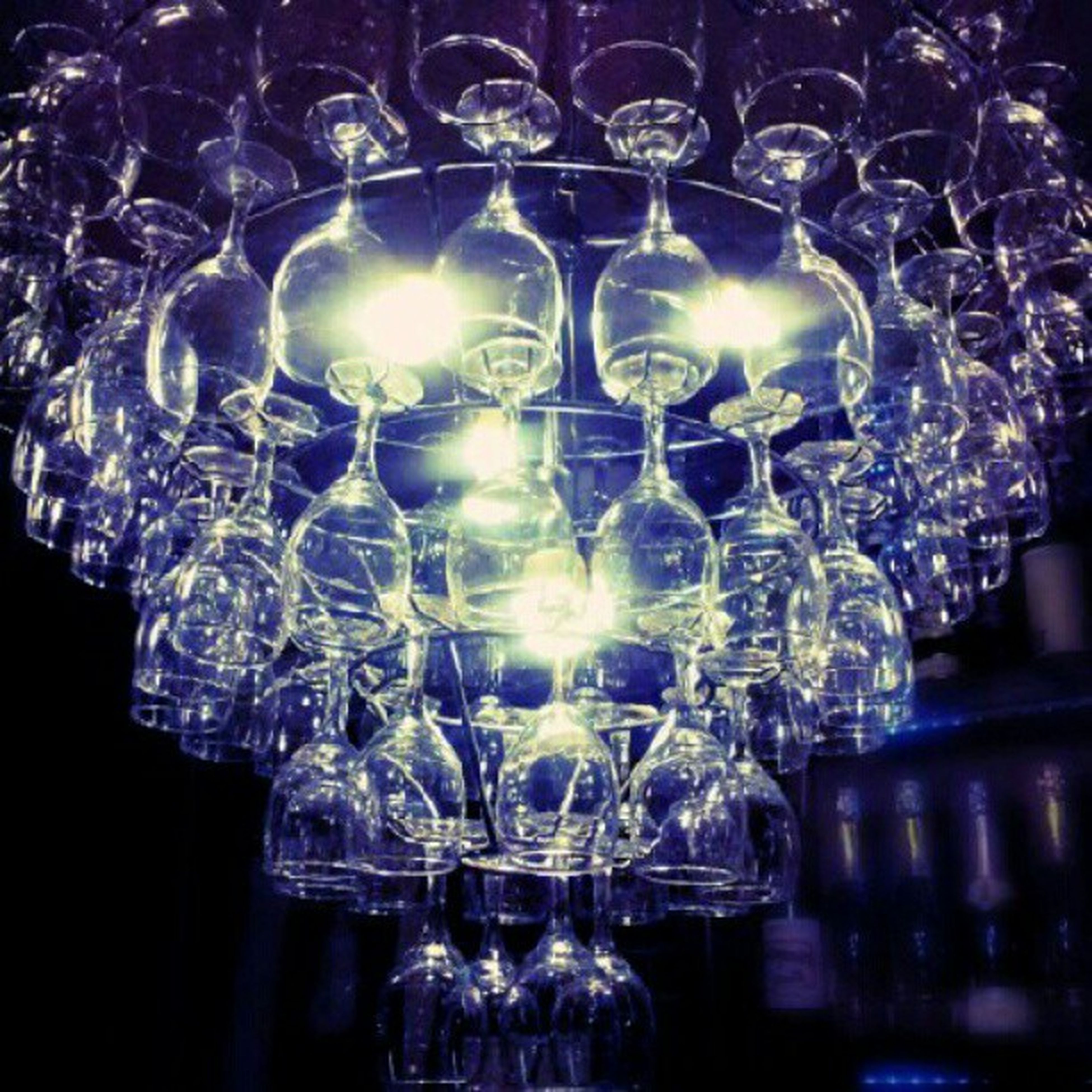 indoors, glass - material, transparent, luxury, reflection, decoration, illuminated, close-up, chandelier, elegance, lighting equipment, decor, pattern, design, wineglass, ceiling, still life, no people, crystal, glowing