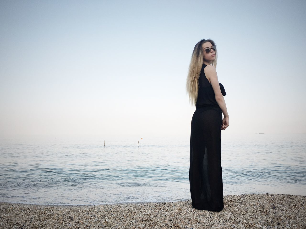 sea, water, standing, horizon over water, one person, nature, real people, clear sky, scenics, beauty in nature, young adult, young women, tranquil scene, beach, leisure activity, outdoors, lifestyles, tranquility, sky, day, full length, beautiful woman, women, people