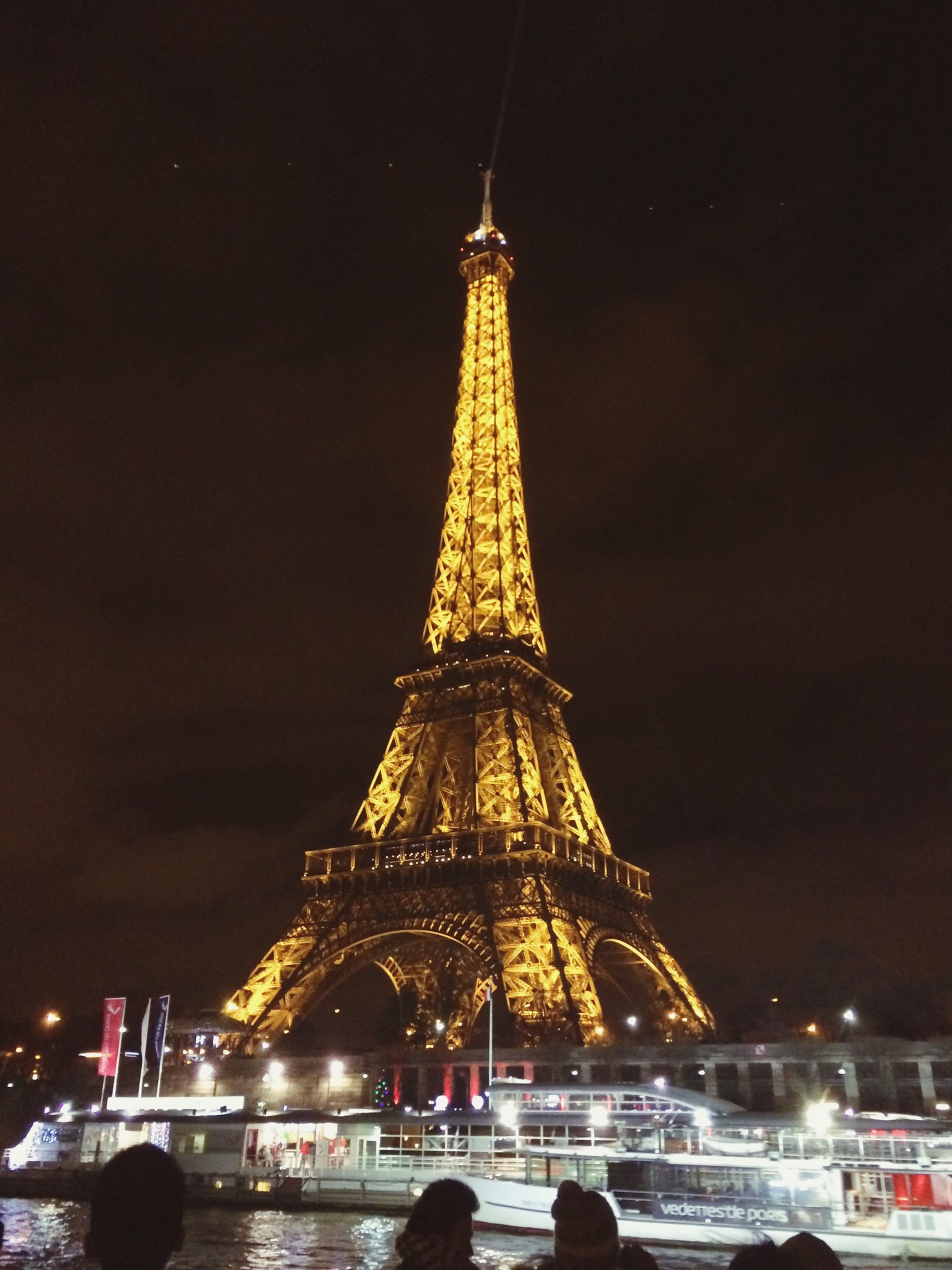 famous place, travel destinations, international landmark, illuminated, tourism, architecture, eiffel tower, built structure, capital cities, travel, night, city, sky, tower, tall - high, culture, building exterior, dusk, city life, history