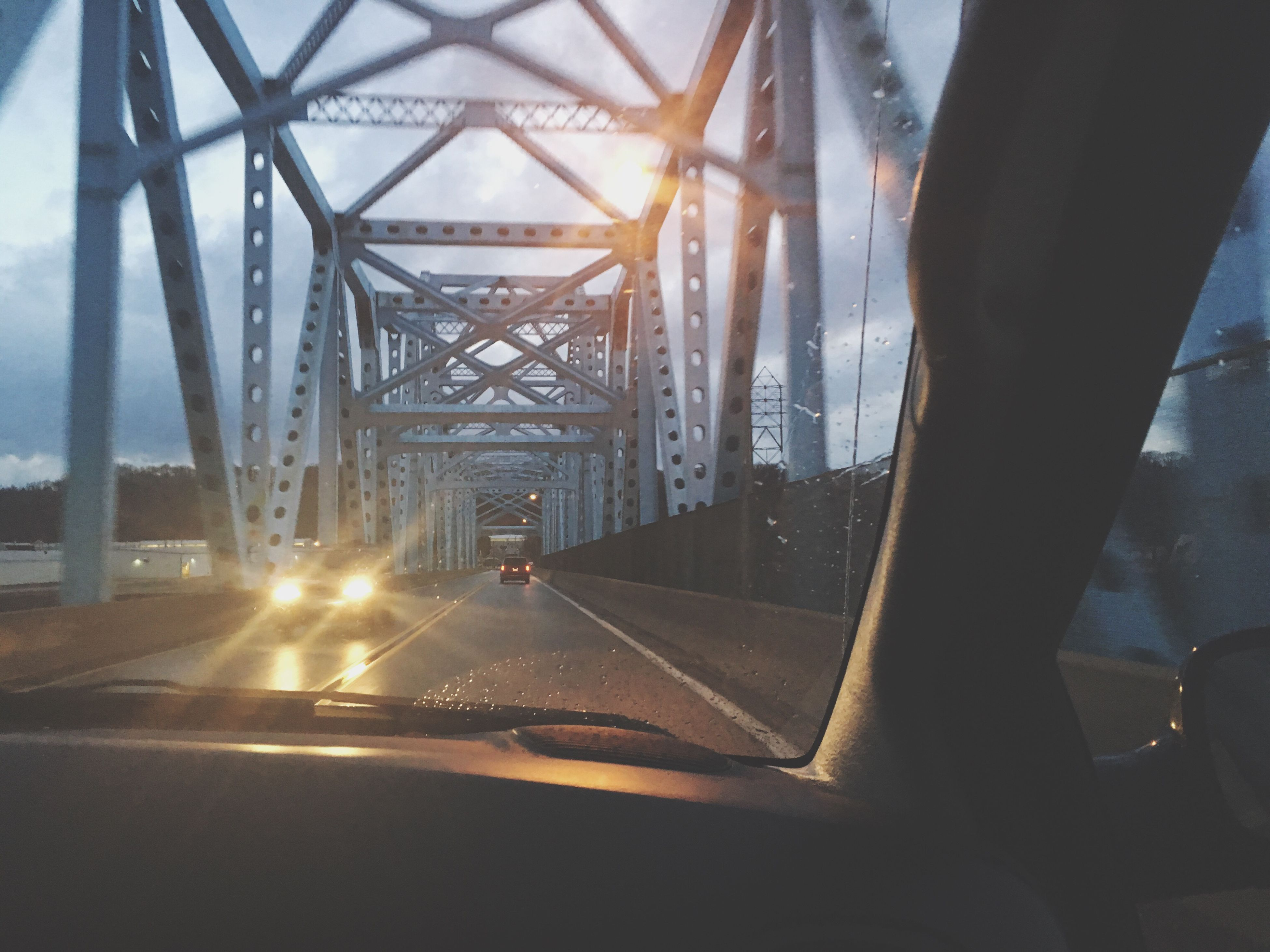 transportation, car, car interior, road, vehicle interior, windshield, land vehicle, driving, mode of transport, human hand, highway, one person, the way forward, real people, bridge - man made structure, architecture, sky, indoors, day, close-up, people