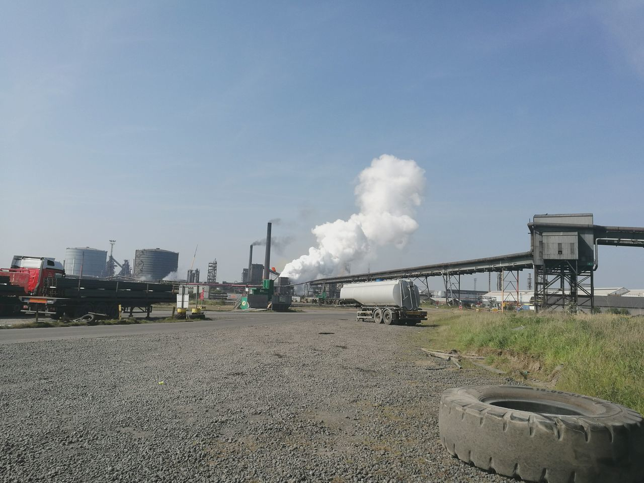 industry, smoke - physical structure, pollution, factory, air pollution, emitting, smoke stack, environmental issues, day, built structure, sky, chimney, fumes, environment, steam train, train - vehicle, outdoors, architecture, no people, locomotive, power station
