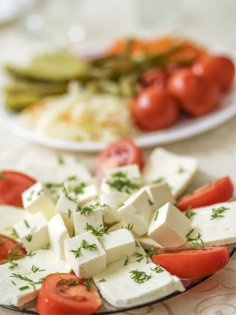 plate of soft cheese (feta and bryndza) with tomatoes Abundance Bryndza Cheese Close-up Day Feta Food Food And Drink Freshness Healthy Eating Indoors  No People Plate Ready-to-eat Soft Table Tomatoes Vegetable