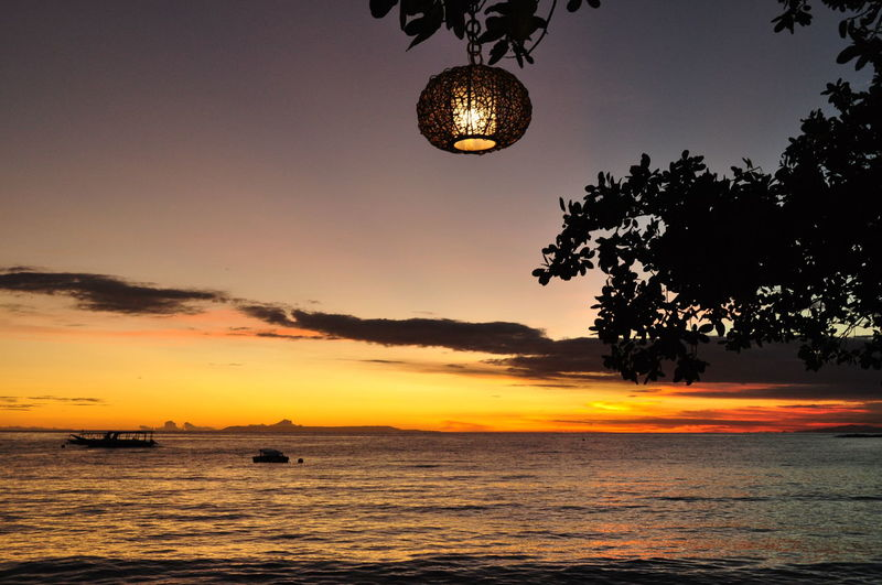 ASIA INDONESIA Lantern Lombok, Indonesia Lombok-Indonesia Sunset_collection Backgrounds Beauty In Nature Lombok Island Nature No People Orange Color Outdoors Scenics Screen Saver Screensaver Sea Silhouette Sky Sunset Sunsets Tree Water