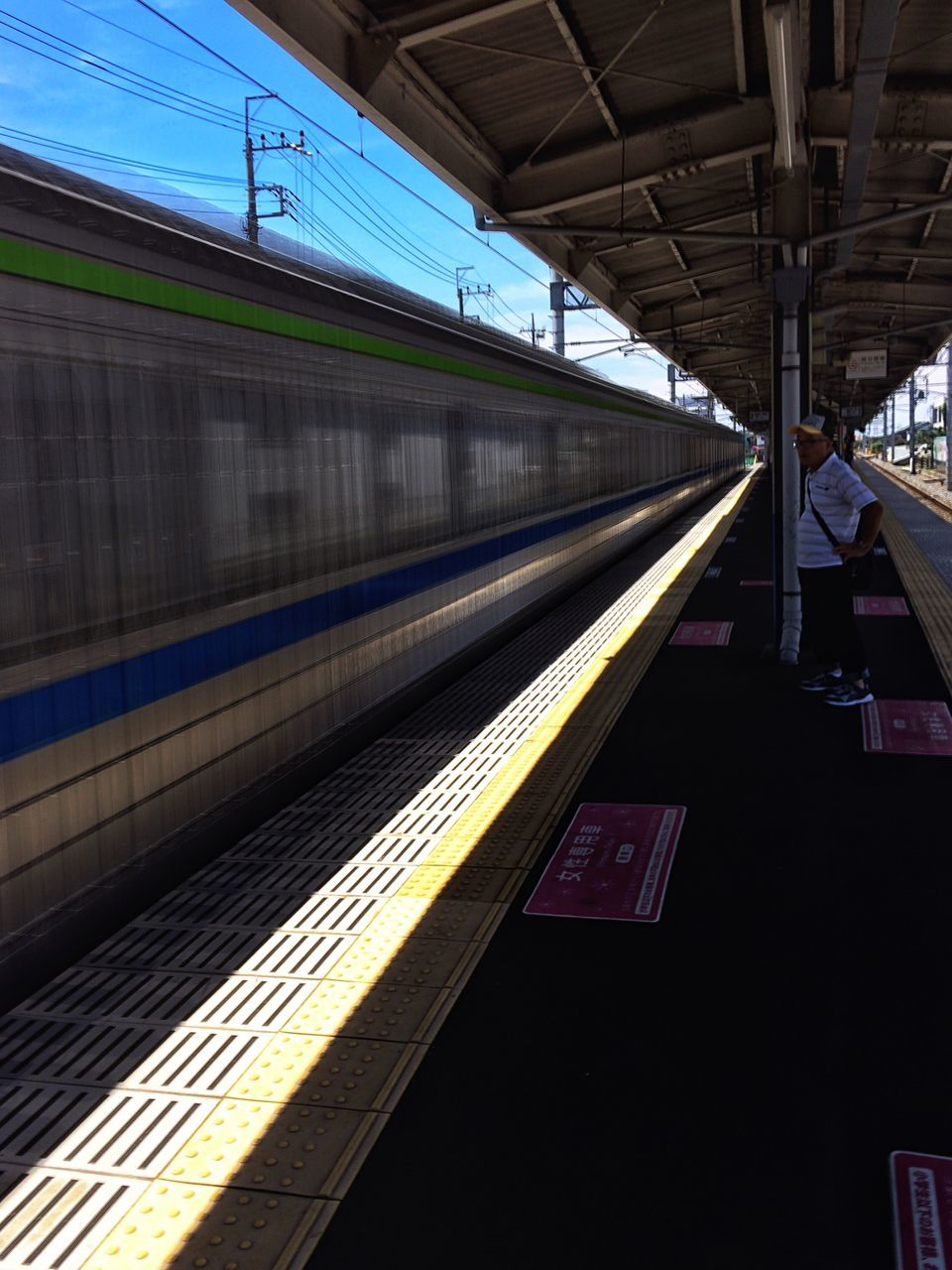 Blurred Motion Of Train On Railroad Station Platform