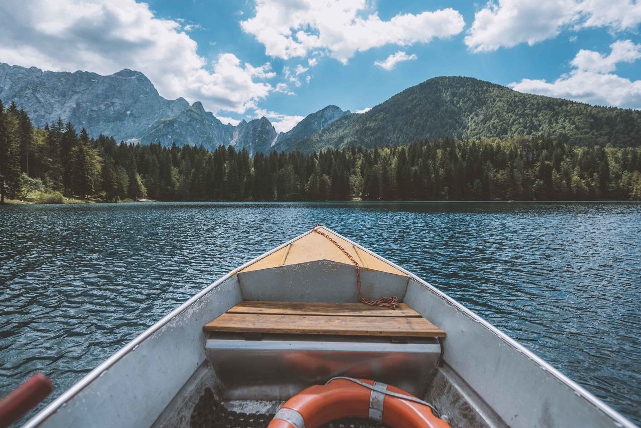 Beauty In Nature Boat Boat Ride Day Forest Italy Lake Landscape Mountain Mountain Range Nature Nautical Vessel No People Outdoors Scenics Sky Tree Water
