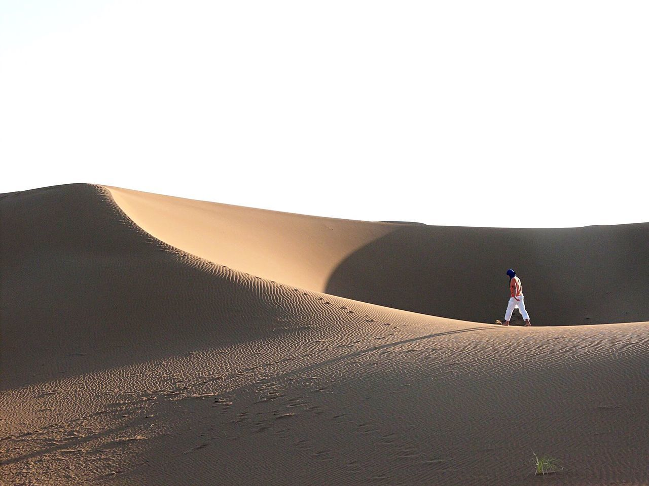 Walking in the desert at Erg Chegaga in Morocco Morocco Travel Photography Desert Edge Of The World Deserts Around The World Sand Empty Places Loneliness Desert Beauty People And Places