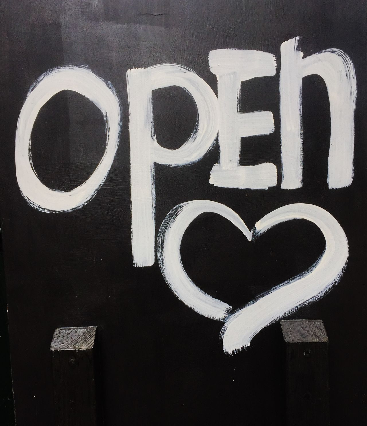 Challboard showing the term open with heart shape Blackboard  Chalkboard Communication Heart Shape Information Sign Open Open Heart Sign Welcome