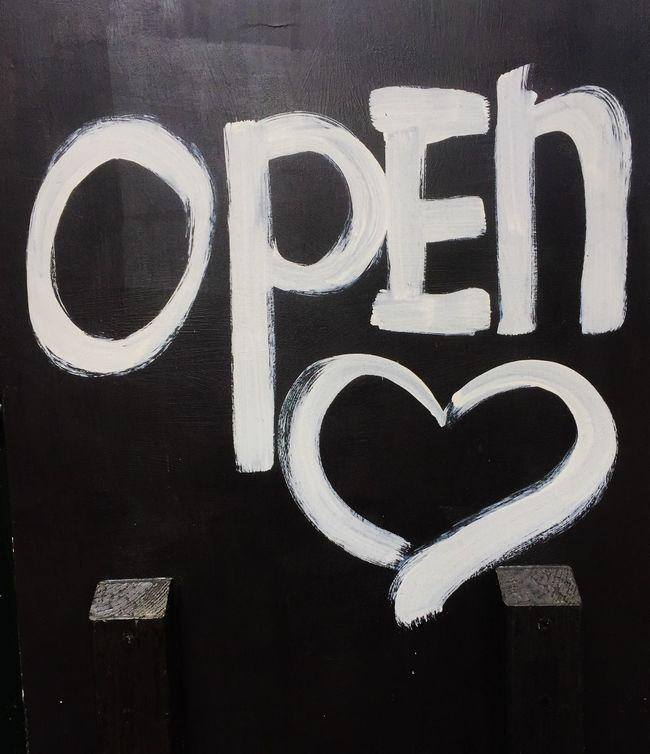 Challboard showing the term open with heart shape Blackboard  Chalkboard Communication Heart Shape Information Sign Open Open Heart Sign Welcome