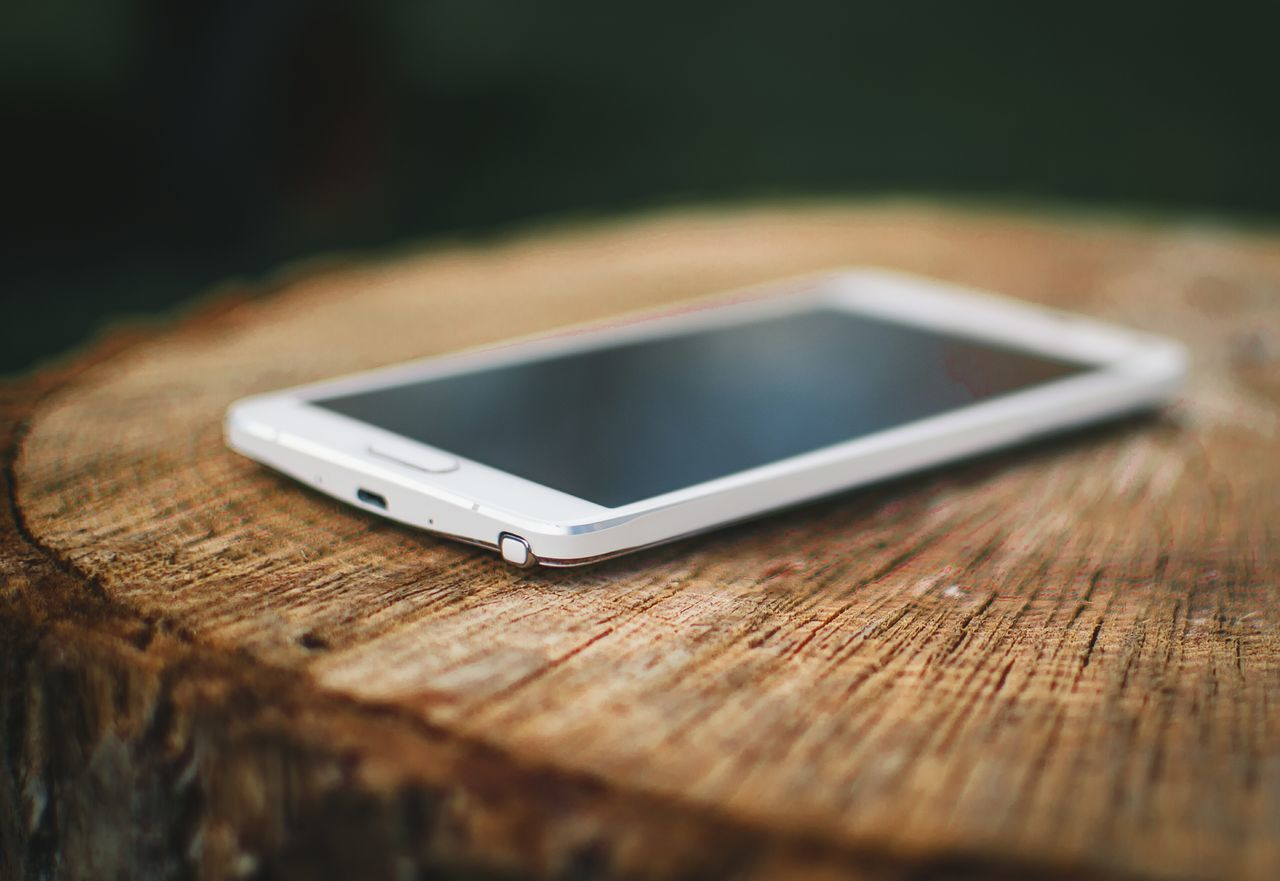 wireless technology, portable information device, technology, mobile phone, communication, smart phone, connection, table, close-up, cellphone, no people, selective focus, screen, telecommunications equipment, indoors, day