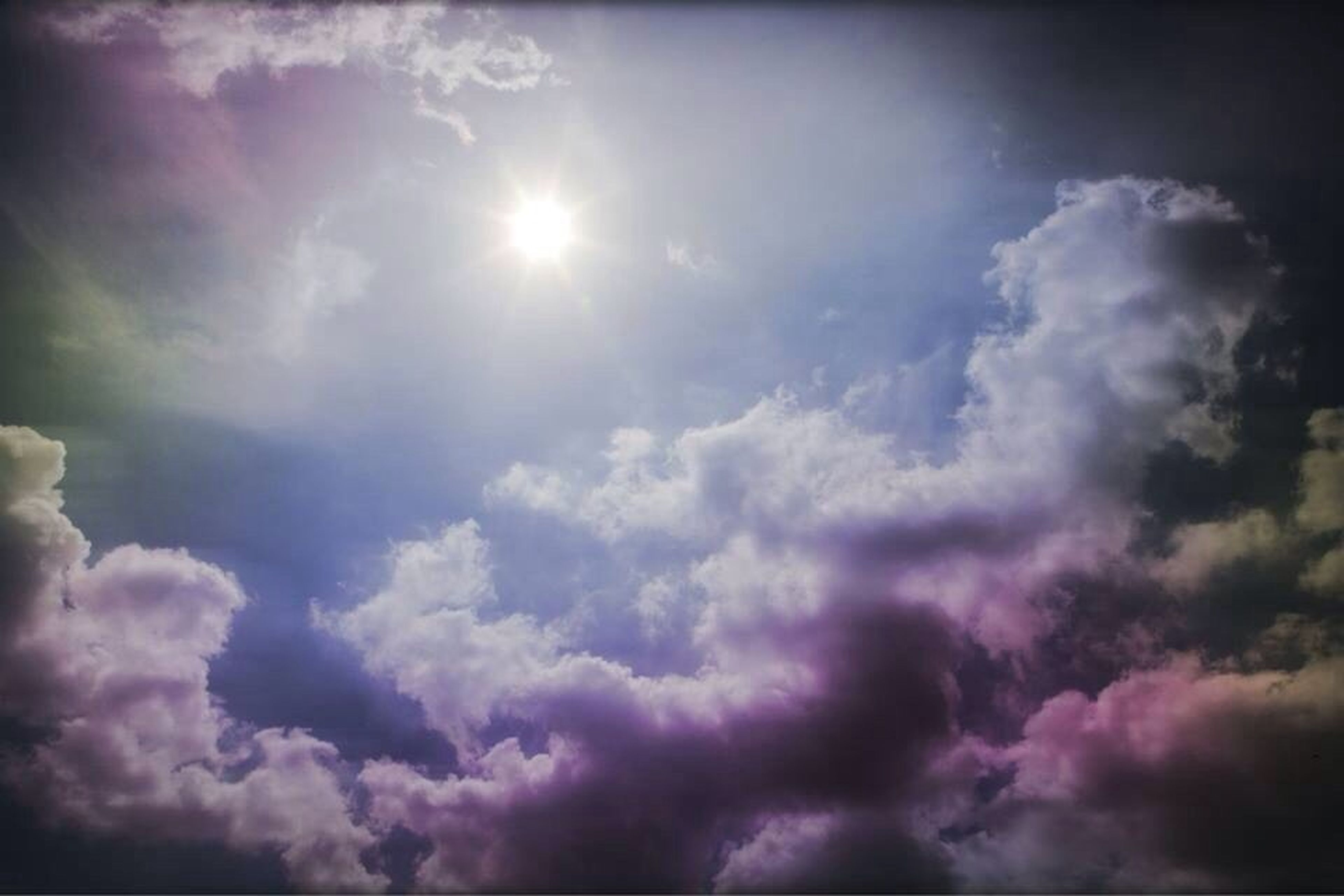sky, cloud - sky, low angle view, sky only, beauty in nature, cloudy, tranquility, sun, scenics, sunbeam, cloudscape, nature, tranquil scene, cloud, sunlight, weather, idyllic, backgrounds, majestic, outdoors