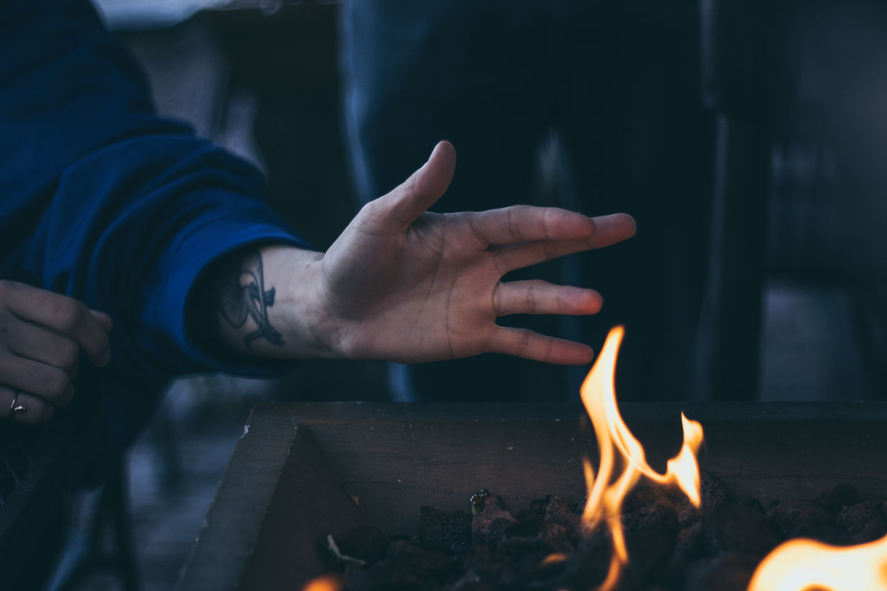 Adult Autumn Autumn Colors Burning Close-up Cold Temperature Fire Flame Hand Heat - Temperature Human Body Part Human Hand Indoors  Leisure Activity Lifestyles Men Natural Night One Person People Real People Winter Young Adult TCPM