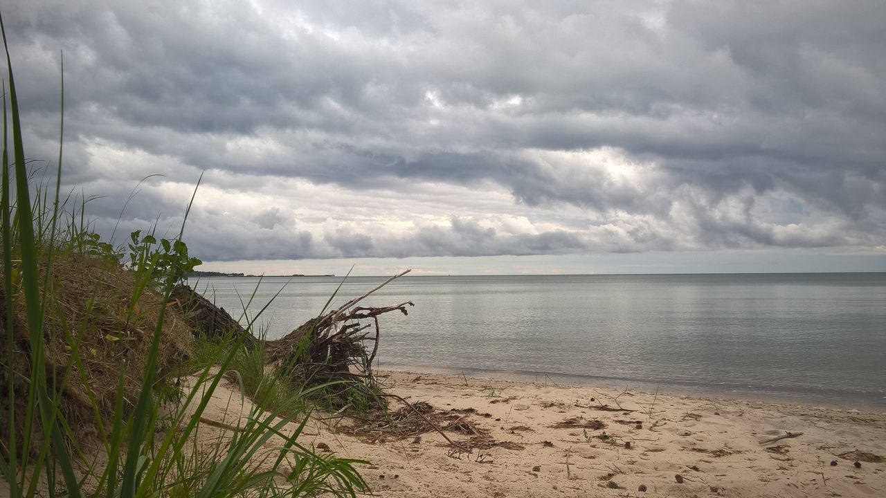Water Sea Beach Nature Cloud - Sky Sand Horizon Over Water Travel Destinations Storm Cloud No People Beauty In Nature Outdoors Tranquility Tranquil Scene Scenics Sky Day Marram Grass Sand & Sea Background Calm Sea No Wind Estonian Nature Hiiumaa Island