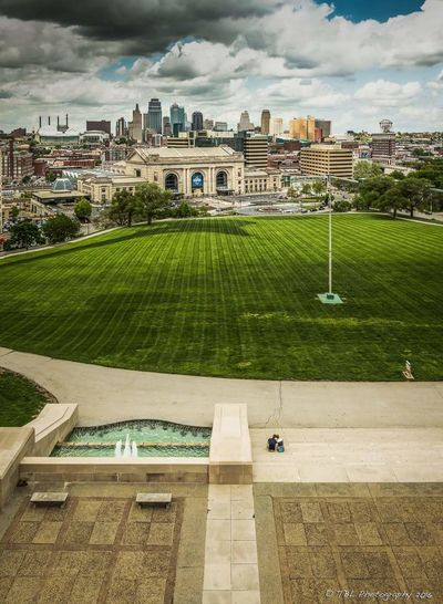 Love at the Liberty. A couple spends a moment overlooking downtown Kansas City. Couple Kansas City Cityscapes Landscape Photography Unionstation Kansascityphotographer