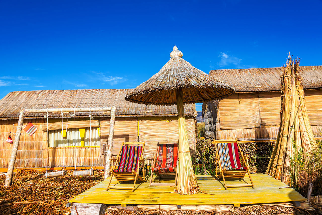 Chairs and a swing set on Uros floating islands near Puno, Peru America Andes Boat Destination Floating Inca Lake Landscape Latin Native Nature Peru Peruvian Puno Puno, Perú Reed Scenic Sky Titicaca Titicaca Lake Totora Travel Uros Uros Island Water