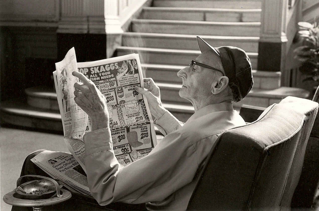 Beautiful stock photos of newspaper, indoors, shop, focus on foreground, mask - disguise