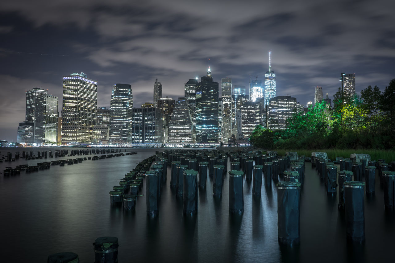 Architecture City Cityscape Downtown District Illuminated Modern Nautical Vessel Night No People Outdoors Sky Skyscraper Travel Travel Destinations Tree Urban Skyline Water