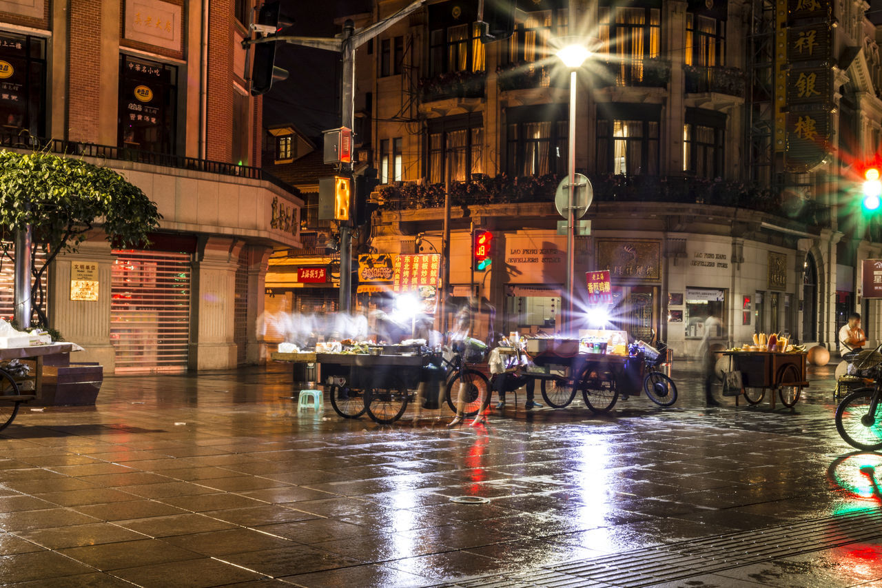 night, illuminated, architecture, city, street, built structure, transportation, land vehicle, building exterior, men, outdoors, riot, people