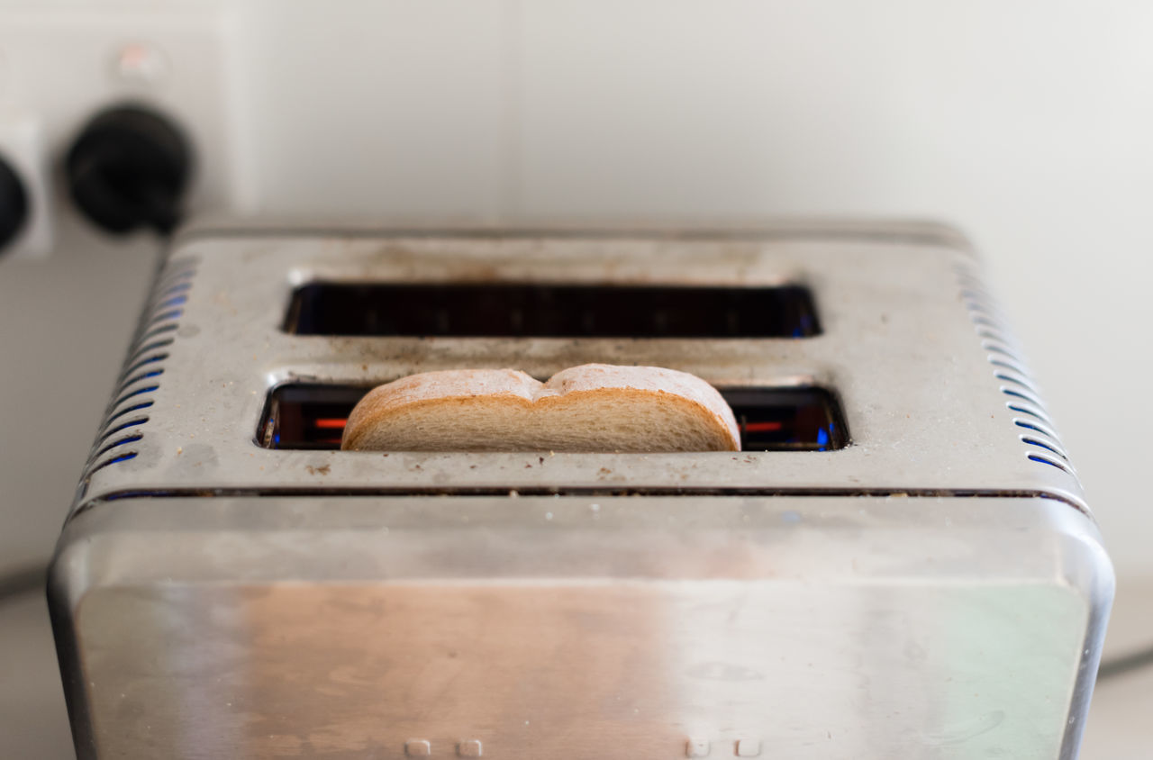 High angle close up view of bread in toaster Appliance Bread Close-up Day Food Food And Drink Freshness Healthy Eating Heat - Temperature Indoors  No People Oven Preparation  Stove Toasted Bread Toaster