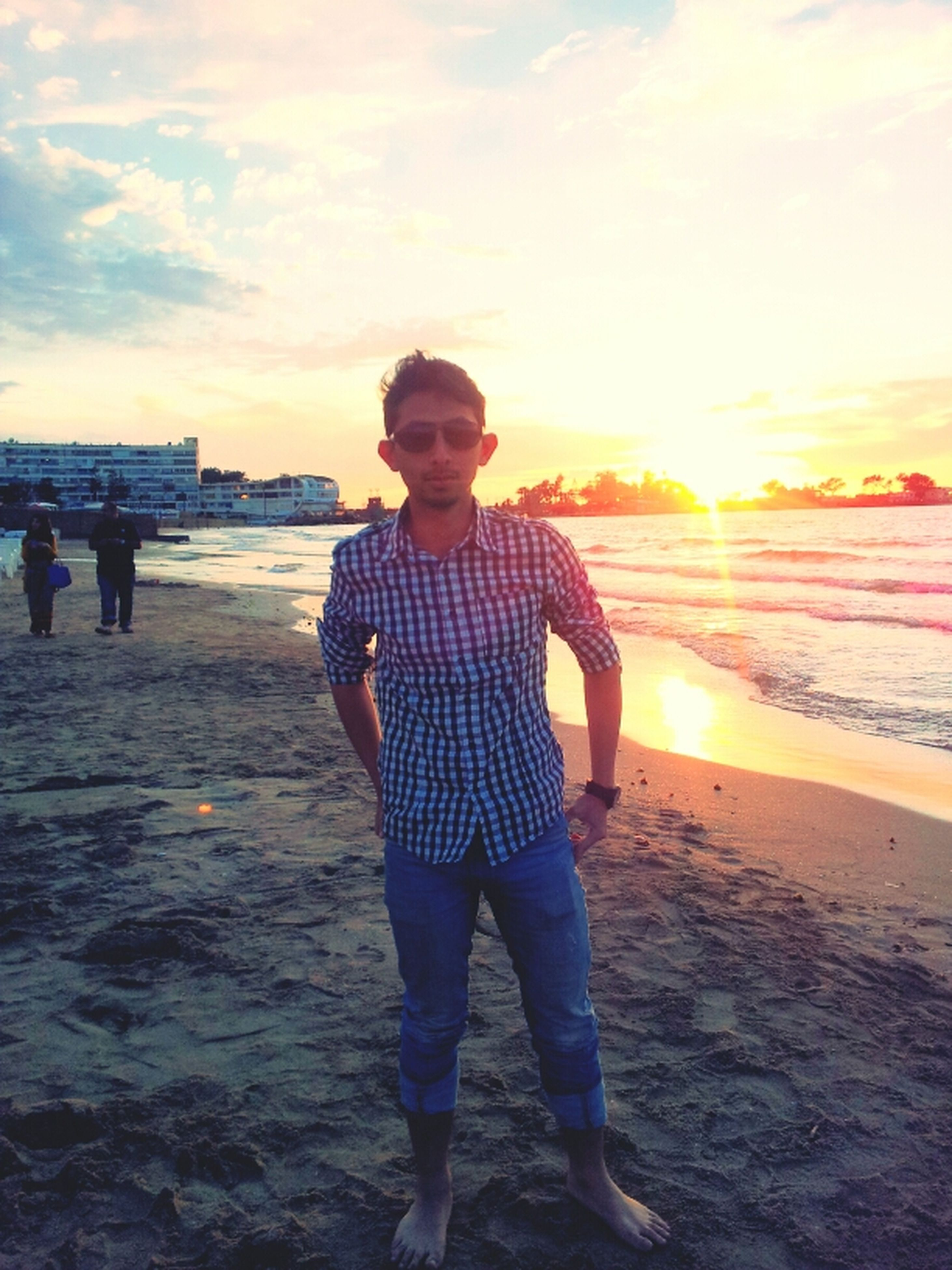 water, beach, sea, sunset, lifestyles, leisure activity, sky, shore, childhood, sand, person, full length, horizon over water, boys, standing, casual clothing, vacations, elementary age