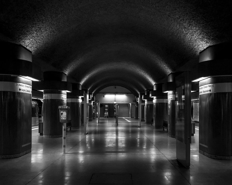 Architectural Column Architecture Blackandwhite Built Structure Column Corridor Empty Illuminated Indoors  Light And Shadow Monochrome No People Reflection Subway Subway Station Symmetry The Way Forward