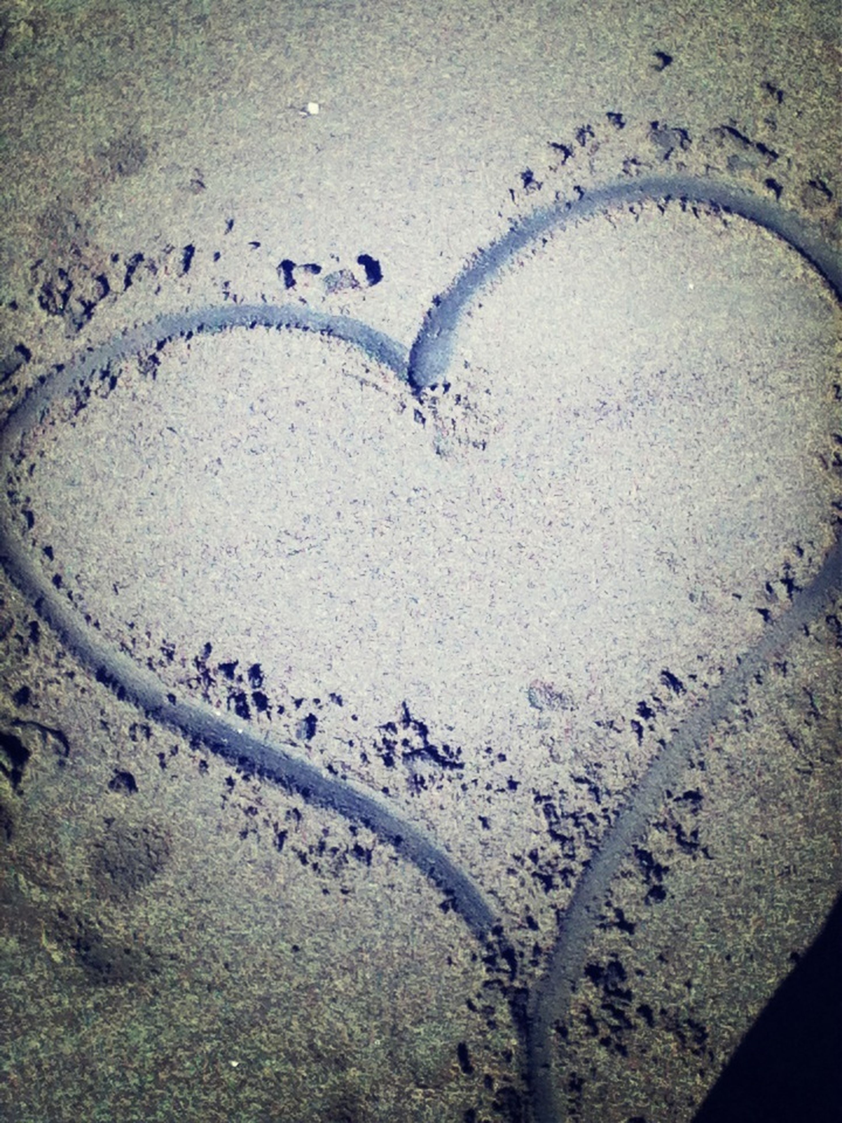 text, western script, communication, high angle view, sand, beach, heart shape, creativity, art and craft, art, wall - building feature, love, full frame, day, footprint, pattern, no people, textured, backgrounds, close-up