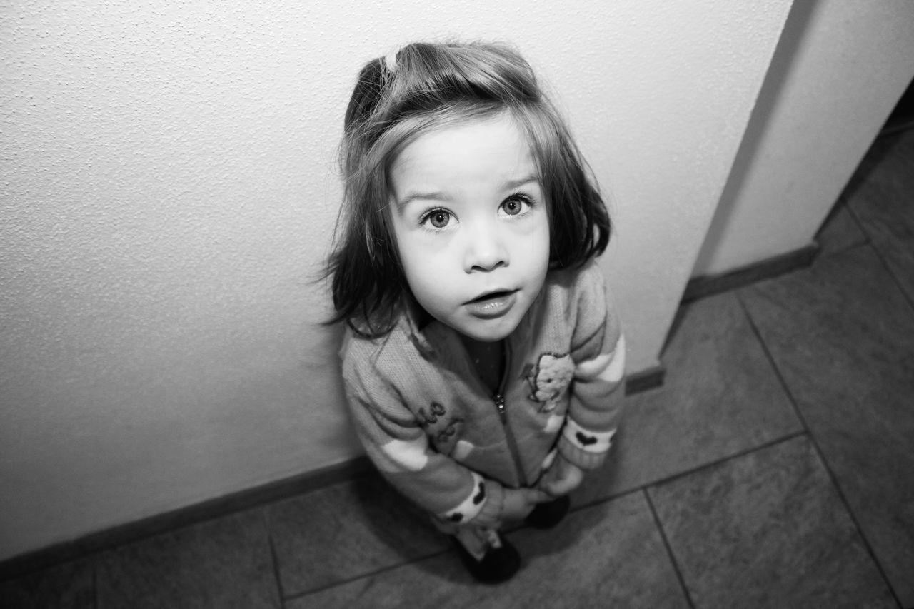 childhood, one person, looking at camera, innocence, child, indoors, children only, one girl only, girls, portrait, cute, full length, sitting, day, real people, people, close-up