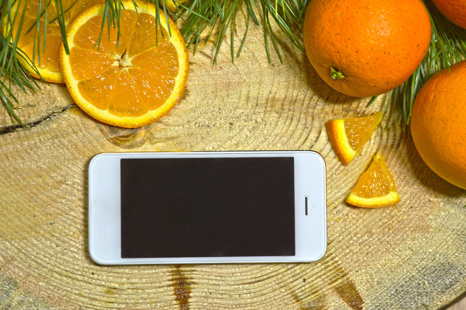 Call Cellphone Photography Citrus Fruit Close-up Decoration Digital Digital Tablet Display Electronics  Food Fruit Healthy Eating Keyboard Network No People Portable Information Device Press Smart Technology Telephone Wireless Technology Wood