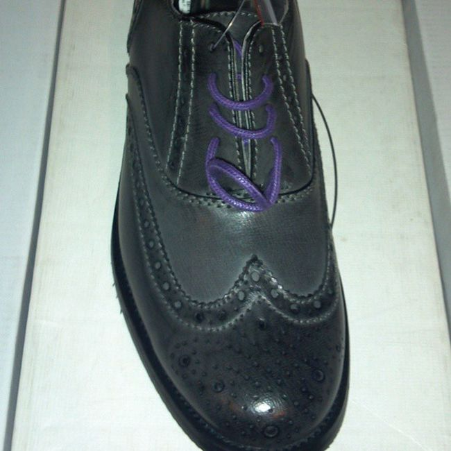 Option 1 Smoke gray Wingtips with purple shade laces.