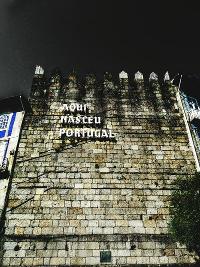 Guimarães berço de Portugal No People Text Low Angle View Close-up Day Sky Wall Portugal Guimarães Night Nikon Snapseed Lightroom Herewasbornportugal Aquinasceuportugal Architecture Muralha Oldtown Defense