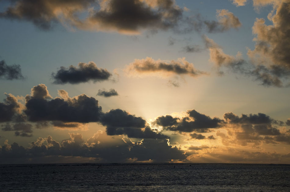Sun setting behind dark Clouds over South Pacific Ocean - Rarotonga, Cook Islands, Polynesia Backgrounds Cloud Cloudscape Cumulus Cloud Dramatic Sky Horizon Over Water Meteorology Nature No People Ocean Scenics Sea Sea And Sky Seascape Storm Cloud Sunbeam Sunset Sunset Silhouettes Sunset_collection Tourism Tropical Tropical Climate Vacations Water Weather