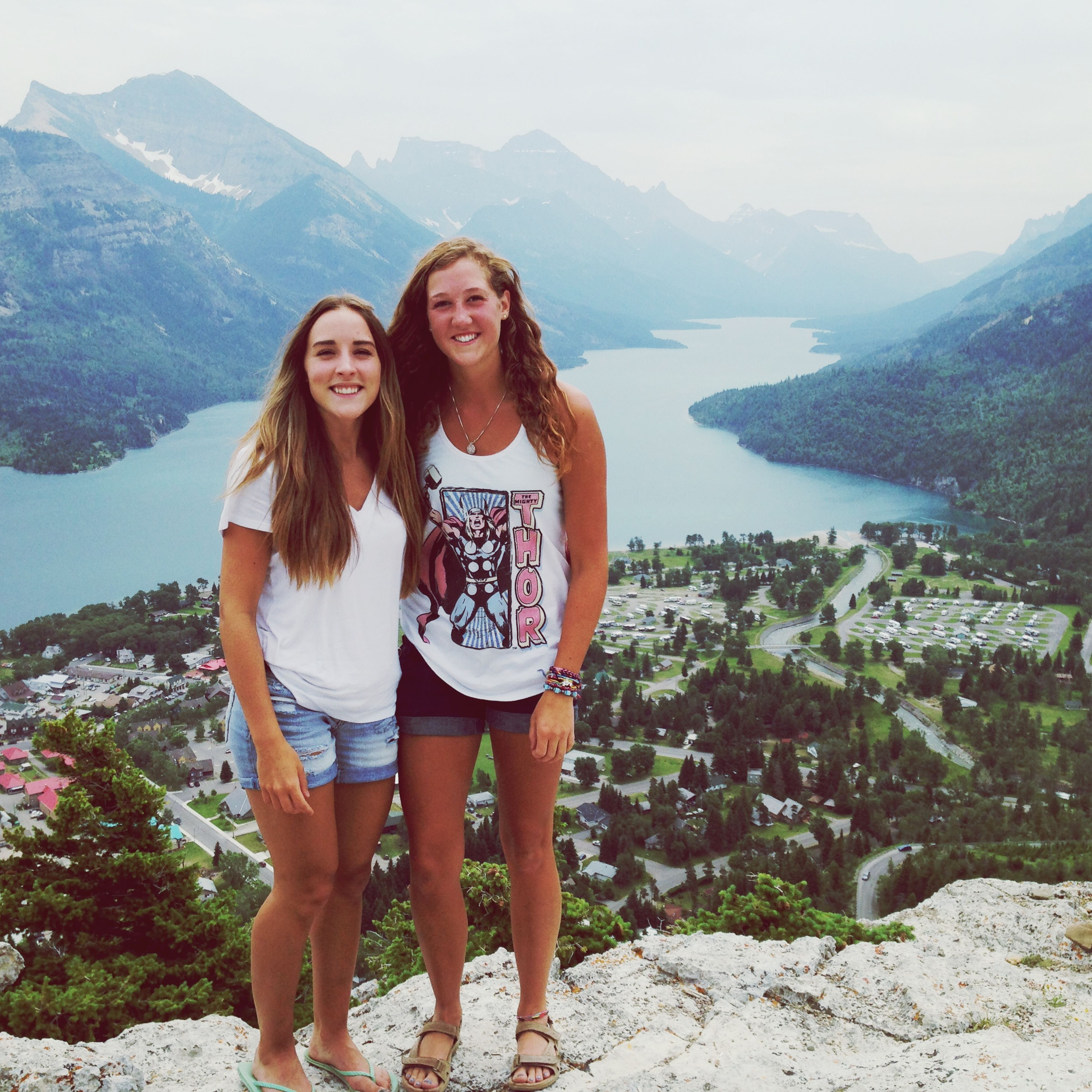 young adult, lifestyles, young women, person, mountain, leisure activity, casual clothing, standing, smiling, portrait, looking at camera, three quarter length, vacations, front view, full length, water, happiness, mountain range