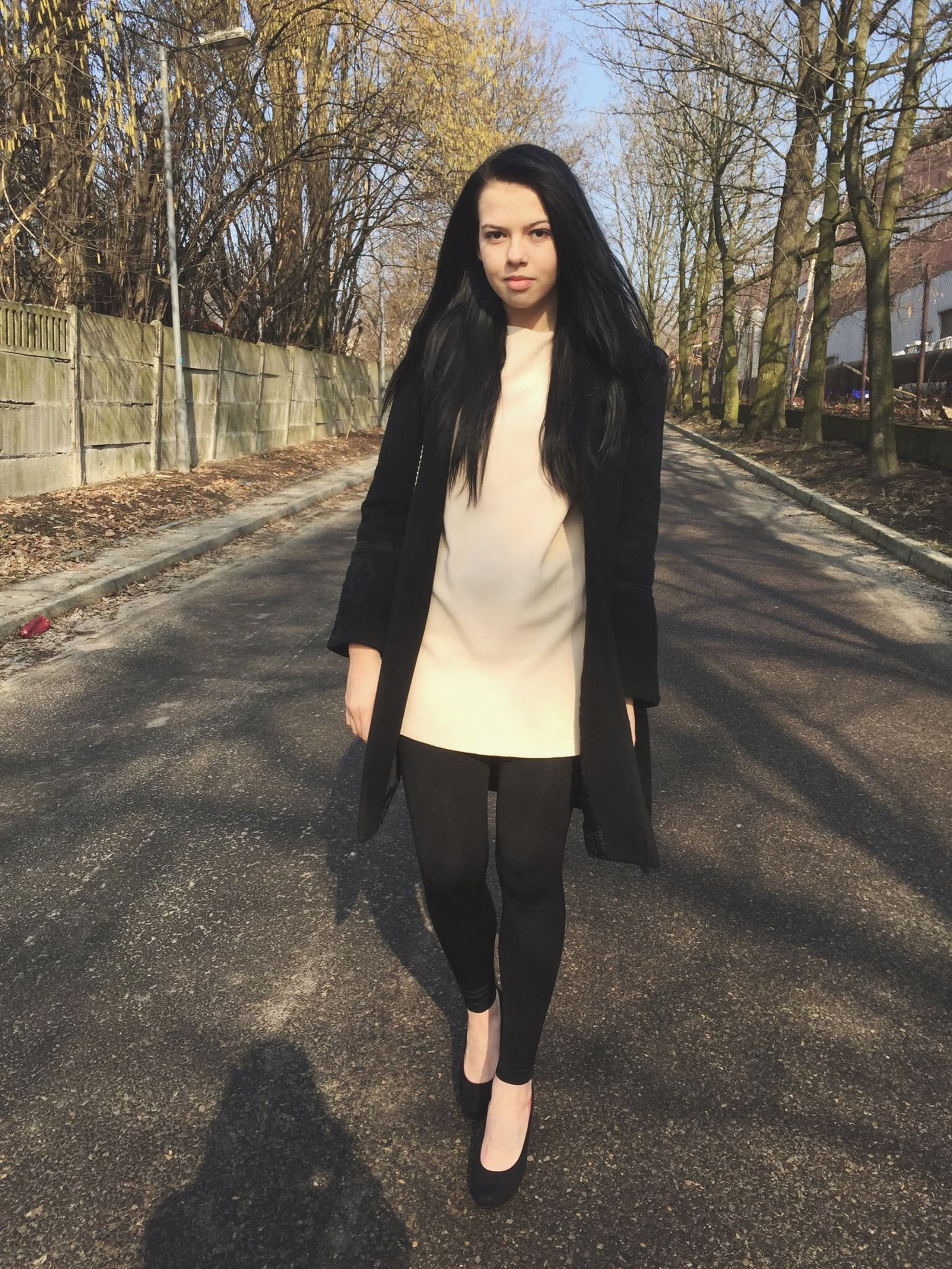 young adult, person, looking at camera, young women, front view, portrait, lifestyles, casual clothing, standing, leisure activity, long hair, full length, smiling, fashion, road, street, tree