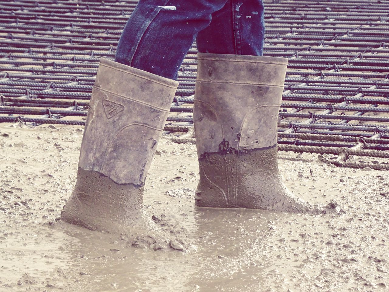 Cement Human Leg Base Concrete Low Section Construction Site Manual Worker Outdoors One Person Standing Real People Occupation Human Body Part Day Working Close-up Nature People Boots Protection Worker Concrete Floor