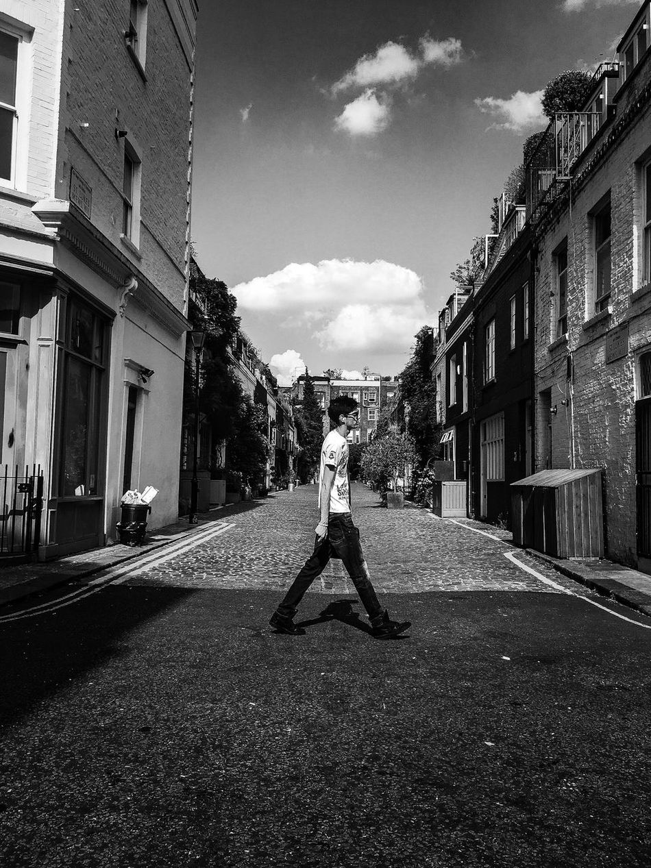 Modern Man Manbag Walking Middle Of Road Centred Shadow Between Legs Symetry Mews Artistic Fine Art Photography Streetphotography Urban Hanging Out Showcase July The Week Of Eyeem Urban Exploration EyeEm Best Shots Shadows Blackandwhite Creative Photography Fine Art l can't believe how lucky I was to capture this shot!...So many things have fallen into place!